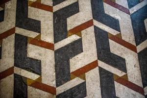 Old red and white geometric flooring photo