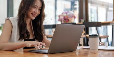 Businesswoman working in finance and accounting, analyze financial budget at home, work from home concept photo