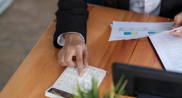 Businesswoman's hands with calculator at the office photo