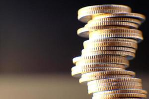 Saving money concept, stacking coins on table background, advertising coins of finance and banking, macro coins photo