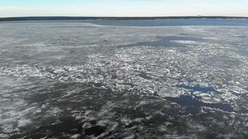 floating ice on a river aerial shot video