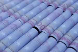 Fondo de dinero de billetes de dólar euro y ahorro de dinero y concepto de crecimiento empresarial foto