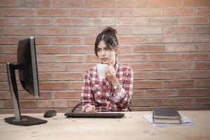 Beautiful woman is working in home office photo