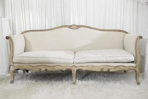 White elegance luxury wooden sofa in wedding ceremony photo
