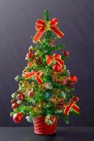 Christmas tree on blackboard background photo