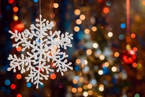 Christmas decorations on bokeh background with out of focus lights photo