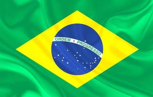 Brazil country flag on wavy silk textile background photo