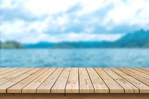empty wooden table top on sea background, used for display or montage your products photo
