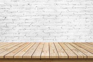 empty wooden table top on white brick wall background, used for display or montage your products photo