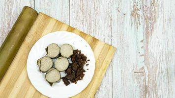 Delicious Delicay Food Lemang and Rendang photo