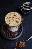 Dalgona Coffee, a trendy cool fluffy creamy whipped coffee. photo