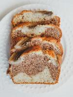 Homemade banana bread with cinnamon and walnuts. photo