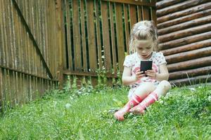 Young preschooler using smartphone kids using digital technology photo