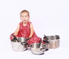 Little child using cuisine accessories having fun photo