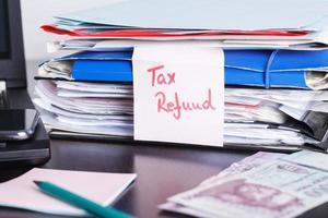 papeleo de reembolso de impuestos, estado financiero, foto