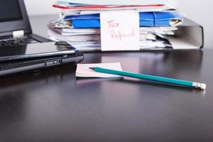 Tax refund paperwork, financial status , photo