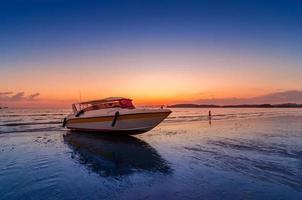 Beach evening sea speed boat cloudy at Ao Nang Krabi Thailand photo