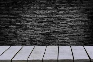 table empty The background is brick wall Empty top wooden shelves and stone wall background photo