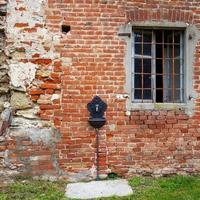 Old, abandoned and ruined house in the hilly region of Monferrato photo