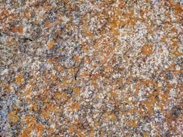 textura fluida de piedra con fragmentos de roca. foto