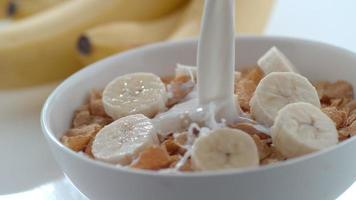 Milk pouring into bowl of cereal and bananas in slow motion shot on Phantom Flex 4K at 1000 fps video