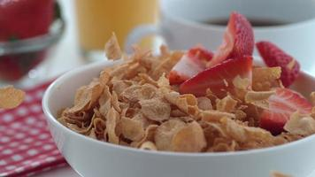 Strawberries falling into cereal in slow motion shot on Phantom Flex 4K at 1000 fps video