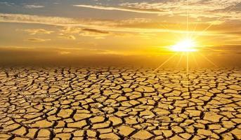 arid Clay soil Sun desert global worming concept cracked scorched earth soil drought desert landscape dramatic sunset photo