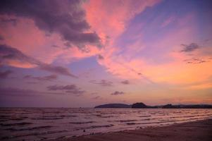 Sea beach in the evening yellow sky pink photo