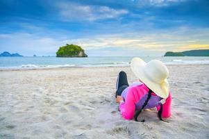 Women wearing hats are sleeping on the beach sea photo