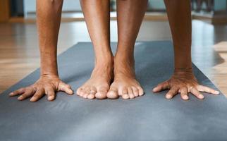Standing Forward Bend pose in yoga iyengar, Uttanasana fold pose close up front view photo