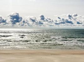 Tranquil summer scene of Baltic sea. Beautiful blue sky and cloudscape. photo