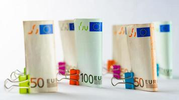 Several hundred euro banknotes. Euro banknotes random stacked. Euro currency money. Banknotes stacked on each other in different positions. photo