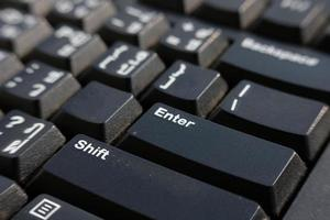 close up keyboard on table and business concept photo