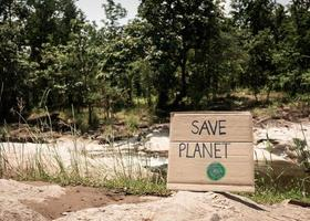 The nature conservation sign on stream flowing background. The concept of World Environment Day. Zero waste. photo