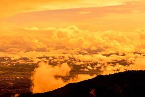 Beautiful landscape at sunset sky with clouds on peak of mountains. photo