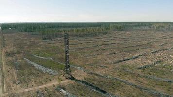 metal tower in the field aerial shooting video