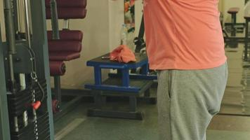 Man doing triceps exercises in the gym video
