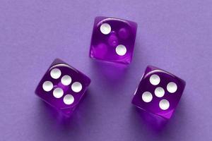 Purple dices on purple background photo