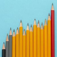 Flat lay pencils on blue background photo