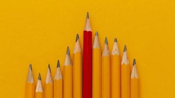 Top view pencils on orange background photo