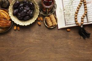 Islamic new year decoration with traditional food and dates photo