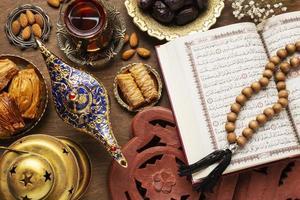 Islamic new year food with praying beads photo