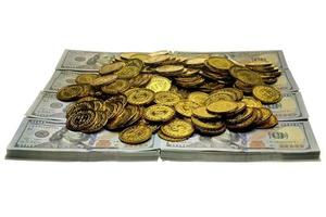 Stack gold coin and money banknote 100 USD photo