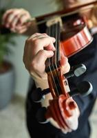 Classical player hands, details of violin playing photo