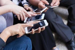 Group of people using smartphones for online shopping or e-commerce concept photo