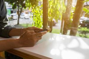 Human hand using smart phone photo
