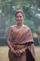 Beautiful Thai woman wearing Thai traditional dress photo