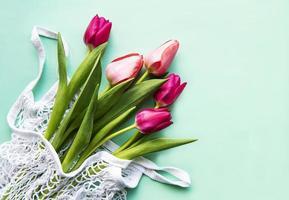 Spring tulips in eco bag photo