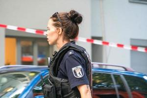 Profile shot of a female police officer at work, Berlin, Germany photo