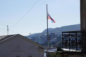 Russian flag on the background of the city Yalta Crimea photo